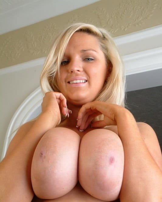 ellie-jay-squeezes-her-huge-tits
