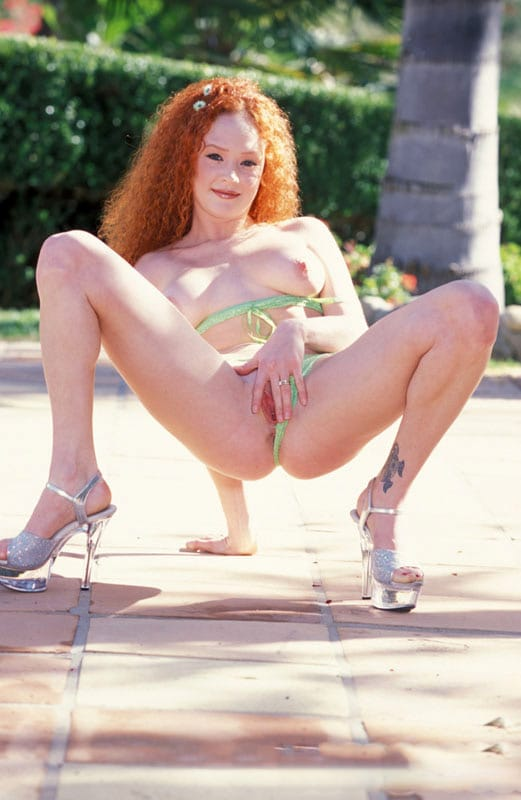gorgeous-audrey-hollander-playing-with-herself-outdoors