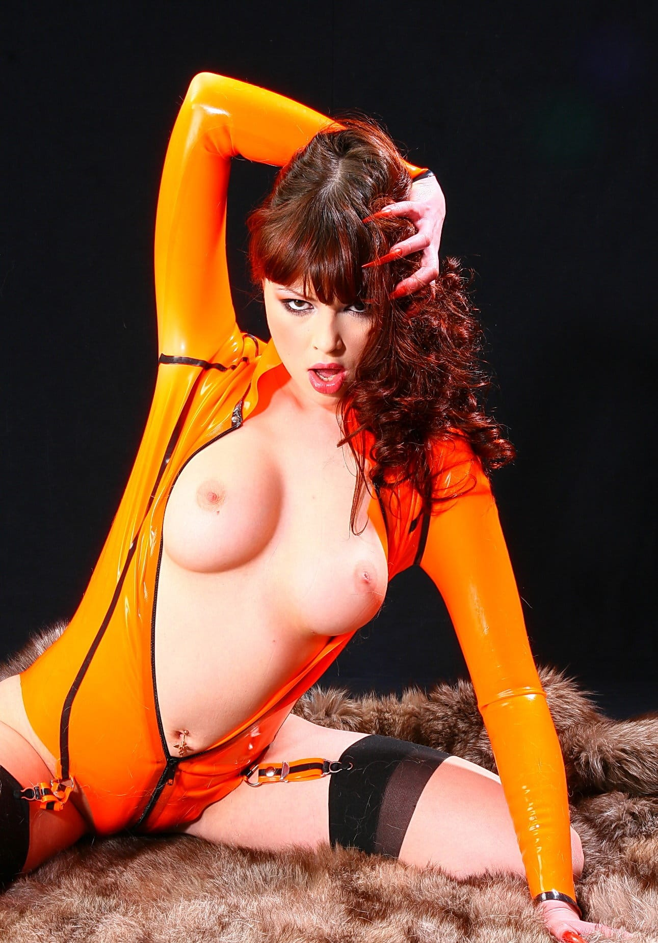 latex-heaven-naughty-babe-in-orange-latex-suit