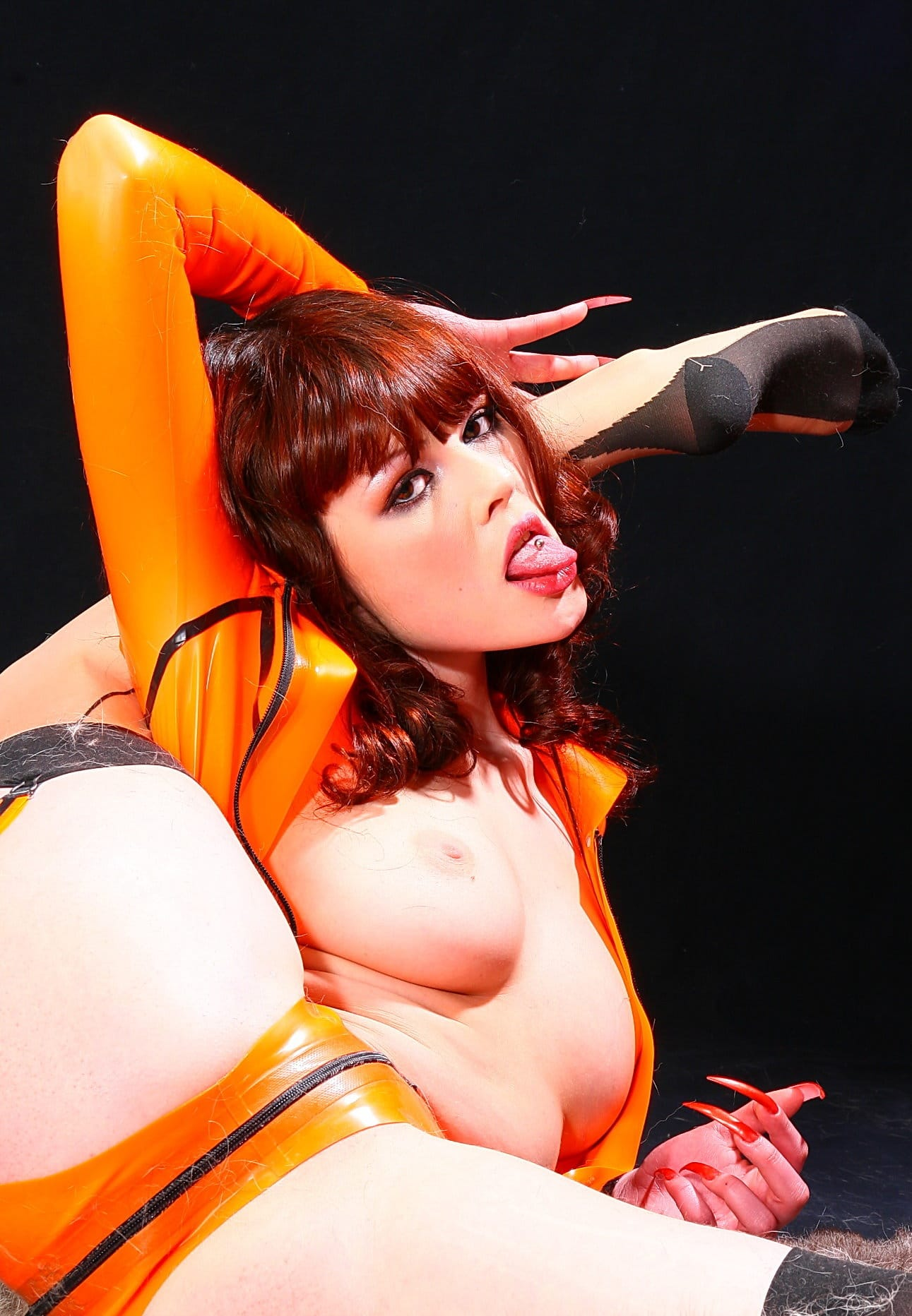 latex-heaven-sexy-babe-in-orange-latex