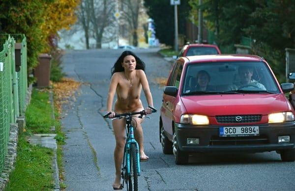 naughty-brunette-biking-nude-in-public