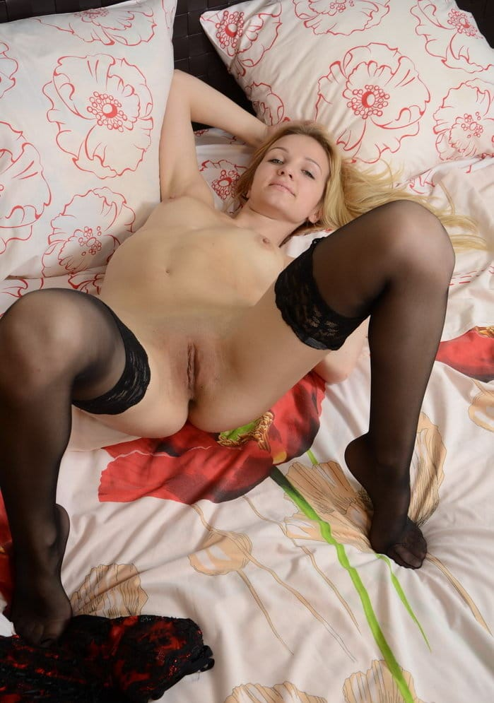 nudolls-slutty-blonde-spreading-wide-on-the-bed